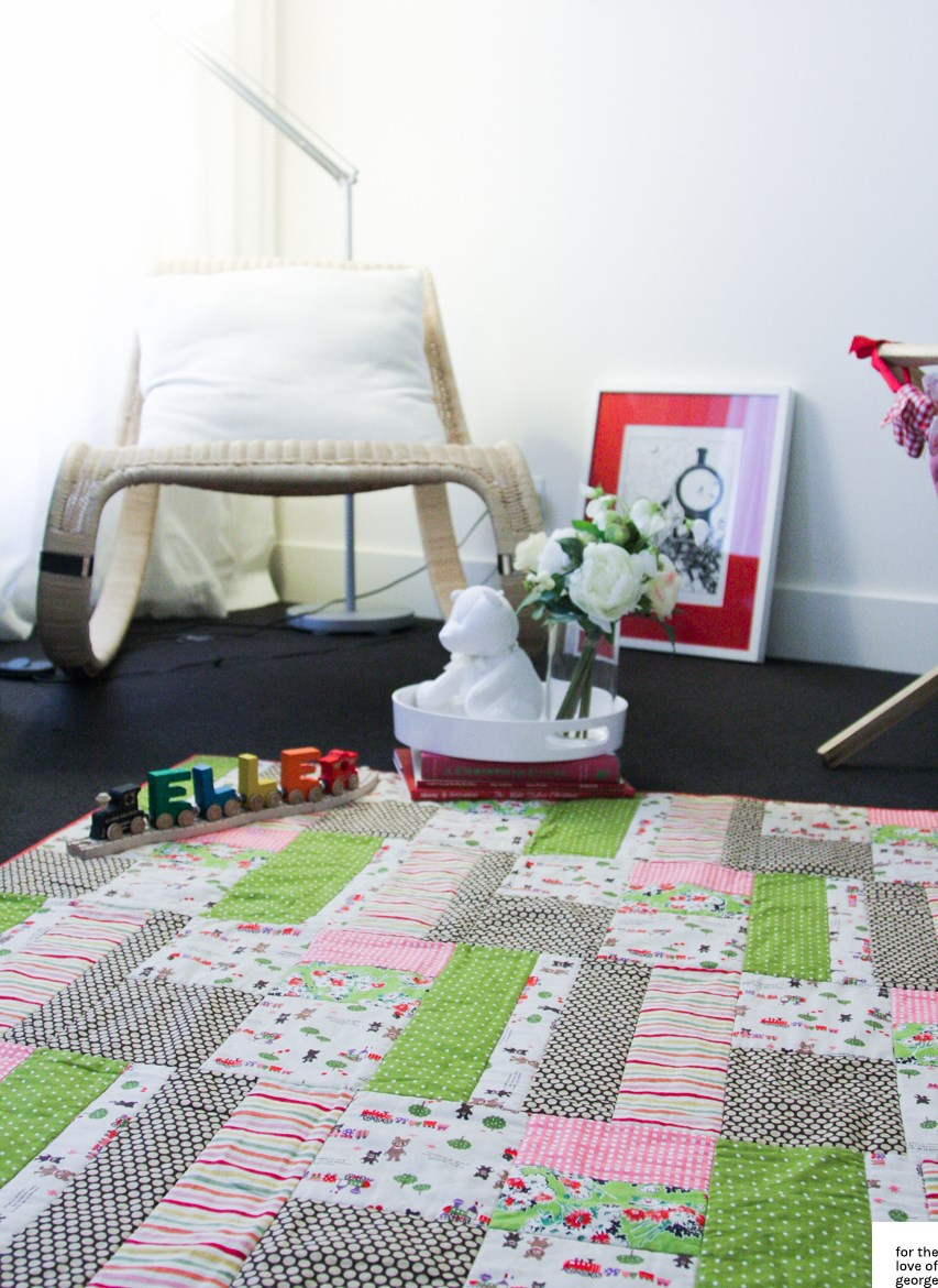 Pink, green, red and brown 'little trains' gender neutral cot quilt on For the Love of George